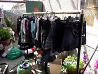 JOB LOT OF OVER 140 DENIM AND OTHER MINI SKIRTS & RAIL