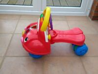 Fisher Price musical walker ride on car