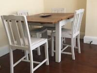 Rustic wooden table and chairs farm style