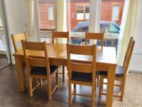 Oak dinning table with six chairs but would seat 10