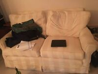 Two seater sofa in good condition. Pick up only.