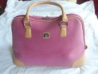 Diane von Furstenberg pink weekend travel bag.