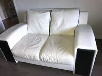 White leather/black leather 2x two seaters. Great condition, very comfortable.
