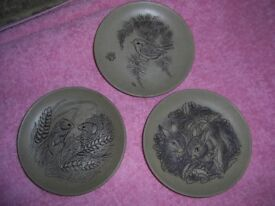Three Pool Potery coster plates depicting a Wren / Rabbits / Harvist Mice.