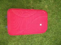 Red travel luggage suitcase