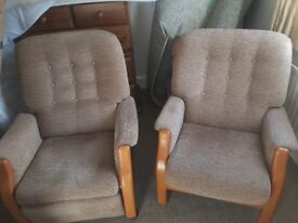 Two Cintique armchairs one is a recliner. Both are in very good condition