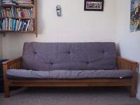 Neat wooden sofa bed futon