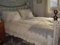 Reproduction King Sized Ivory and Brass Metal Bedstead excluding mattress.