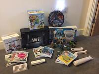 Ultimate Wii bundle in black very little use box as New