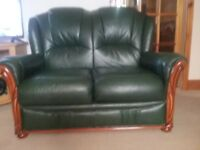 one three seater and one two seater sofa dark green with woodvtrim