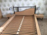 Double bed frame, in very good condition (no mattress) with bedside tables on both sides