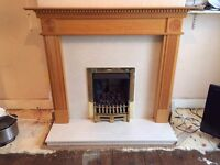 Marble fireplace surround and hearth and wood mantelpiece