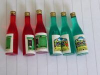 Tiny wine bottles for a doll's house
