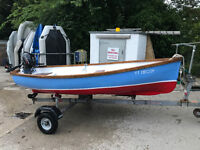 12.6 foot rowing boat with nearly new 2.5 four stroke suzuki with warranty and road trailer