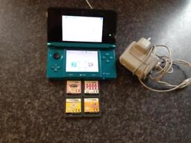 Aqua blue Nintendo 3ds with 4 games