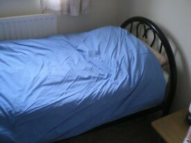 SINGLE BED WITH METAL FRAME AND NEW MATTRESS.