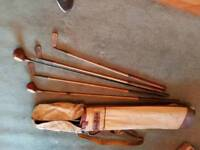 Vintage wooden golf clubs and bag