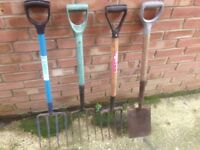 SELECTION OF STURDY GARDEN FORKS AND SPADE .