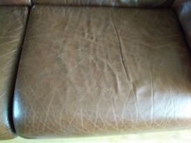 Three seater and chair in brown leather. Very heavy. Small tear on settee and some cracking as shown