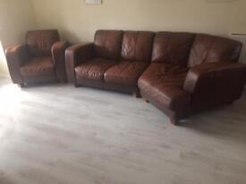 Brown Leather large sofa, armchair and matching footstall.