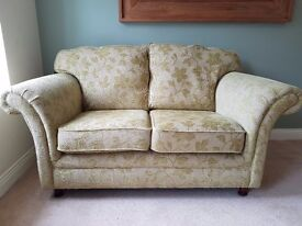 A pair of 2 Seater Green Sofas
