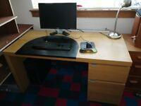 Malm oak veneer desk with cupboard, drawer and black desk pad.