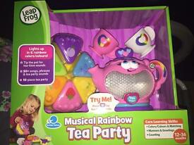 Musical rainbow tea party toy