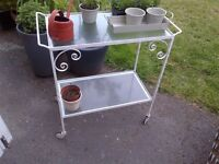 beautiful vintage garden or patio metal trolley on castors with glass shelves