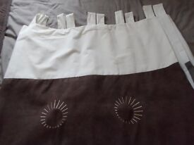 Cream and brown tab top curtains.