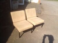 Pair of metal-framed chairs