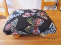Pretty Footstool newly upholstered in butterfly fabric with bun feet