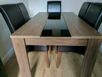 Black Gloss Glass feature Joanna Dinning Room Table and 6 Dark Brown Leather Chairs - £400