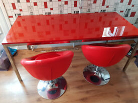 Beautiful modern table and chairs for sale.
