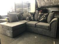 Corner sofa in grey chenille fabric