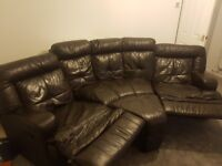 Brown leather sofa and foot stool
