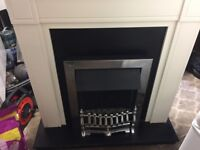 free standing fireplace with electric fire