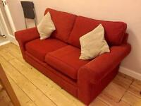 Classic and very comfortable red sofa and arm chair