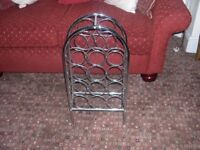 A chrome metal 14 bottle wine rack.