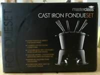 Unused cast iron fondue set & fuel