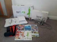 Wii console balance board and games boxed in excellent condition