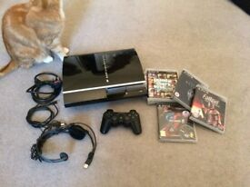 PS3 with controller and 7 games