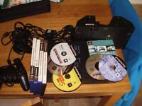PLAYSTATION 2 WITH GAMES AND MULTI TAP STAND FOR 4 PLAYERS