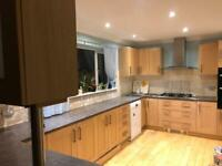 Full oak effect kitchen with sink and cooker