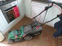 Good lawn mower in working condition. 1600 W