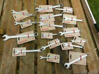 Different Sized New and Used Wrenches