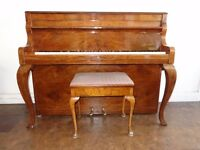 Danemann upright piano in French Provincial case, with matching stool.
