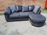 Amazing BRAND NEW grey fabric corner sofa.lovely black leather trim. can deliver
