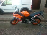 CBR 125 R Year old,only 550 miles. Basically new bike.Repsol colours.