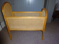 Vintage baby cot. Unique example in american pine finished with woven cane panels