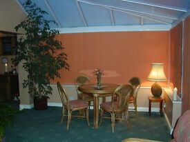 Conservatory/breakfast room table with 4 padded chairs. REDUCED for quick sale.